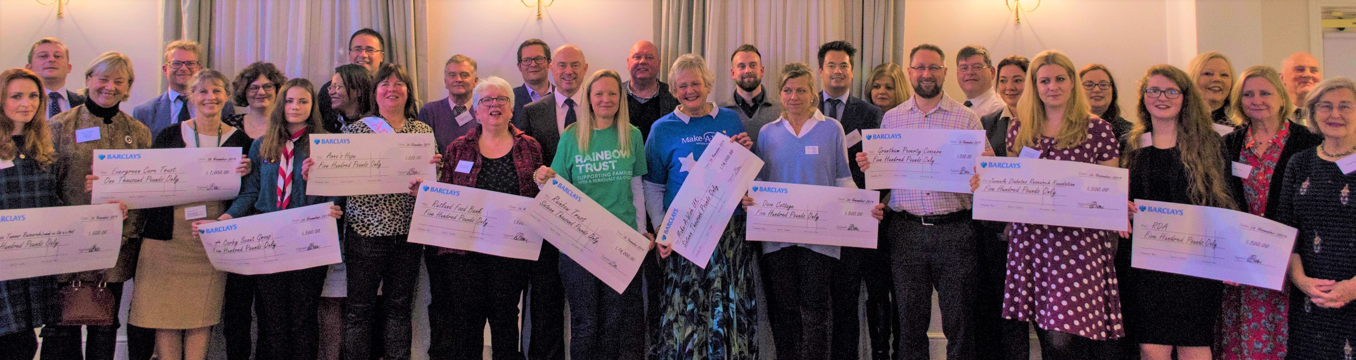 £40K ruby year fundraising cheques are handed over to 17 charities